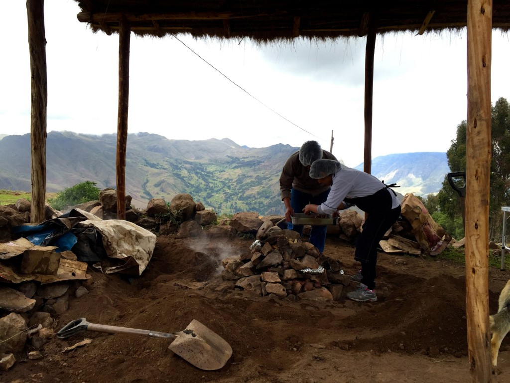 Locals in Peru cooking a Pachamanca lunch.