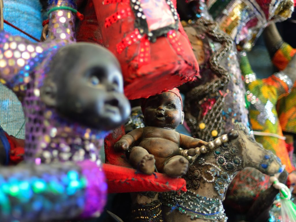 Figurines voodoo on Iron Market in the centre of capital city Haiti credit shutterstock