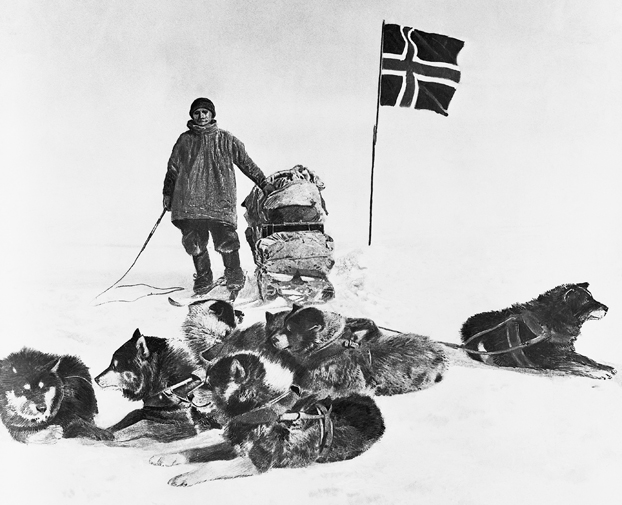 Black and white image of Man with dogs and flag
