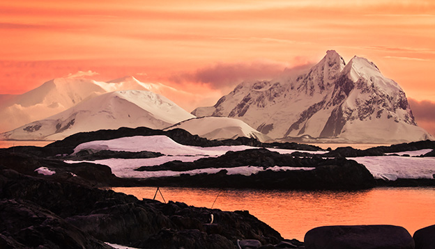 Sunset over sun-capped mountains