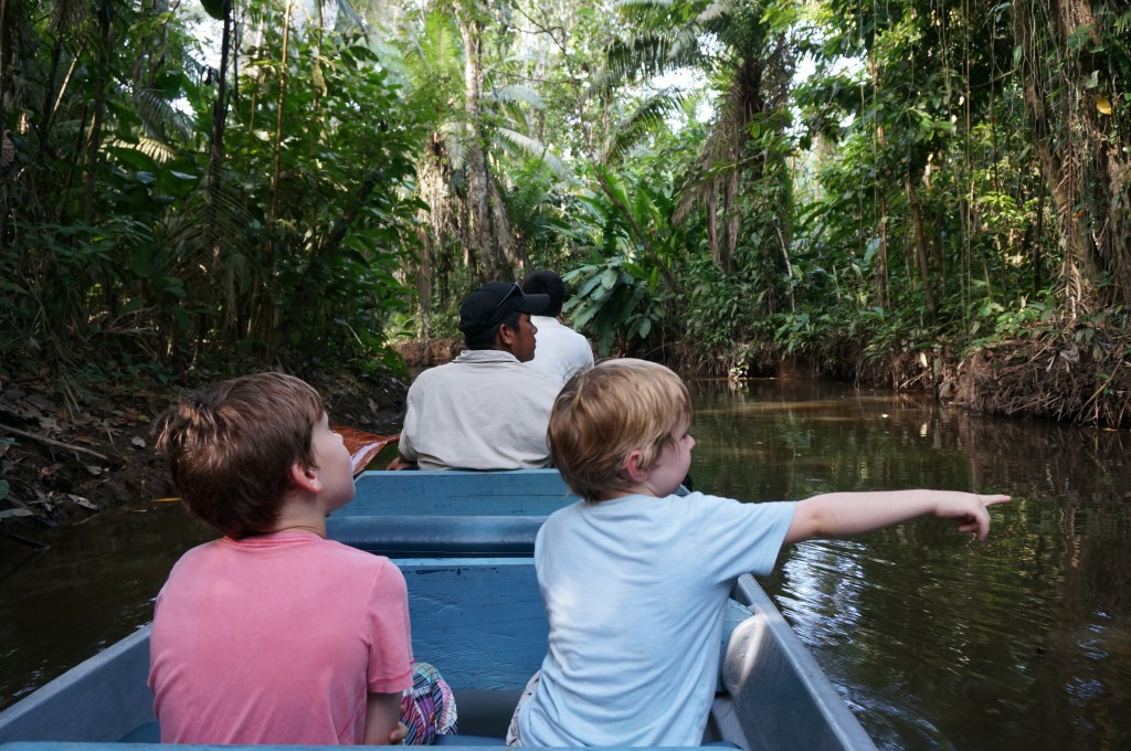 kids in the amazon on canoe
