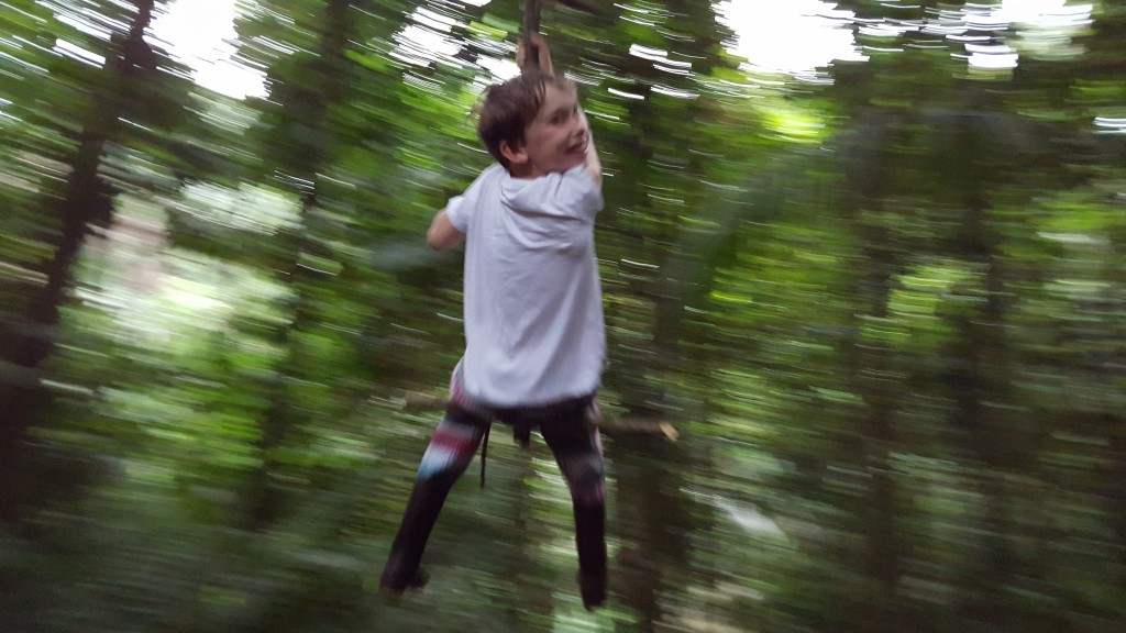 swinging on vines in the Amazon
