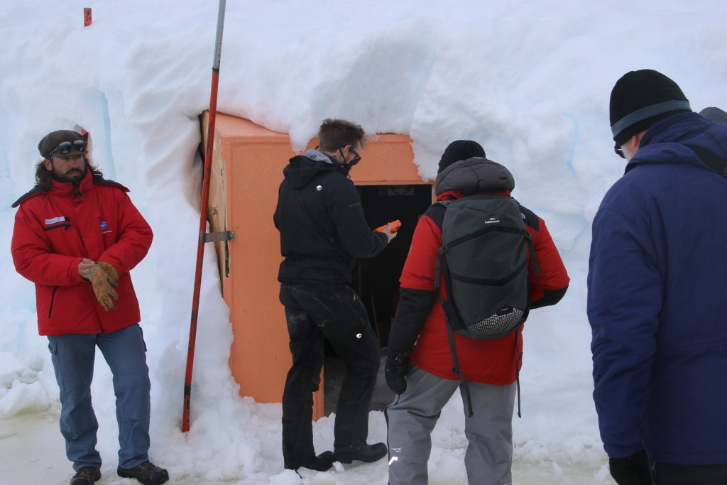 Entering old winter capsule near the French Antarctic Base building