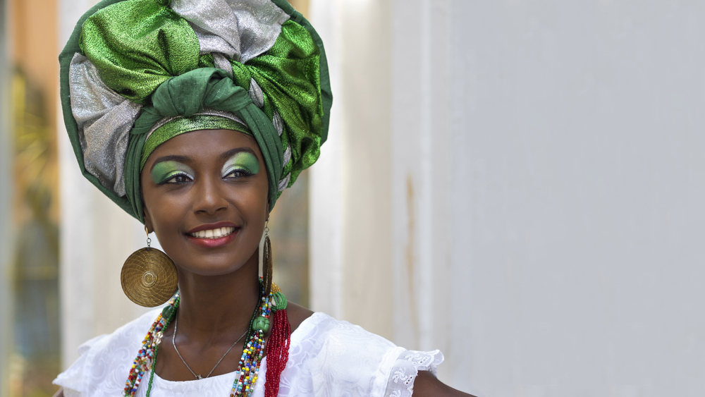 Brazilian woman of African descent, smiling.