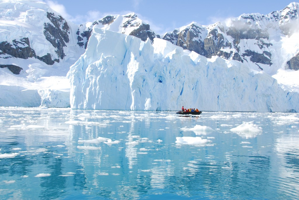 zodiac in front of an ice berg in Antarctica