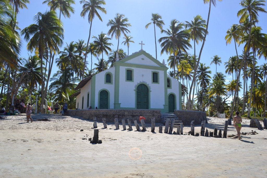White church on the beach of Carneiros surrounded by palmtrees