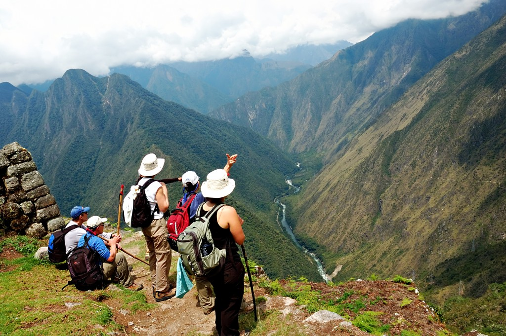 Hikers the Inca Trail in Peru with mountains in the background