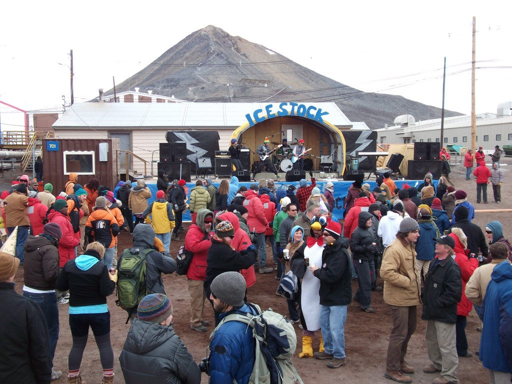a stage named ice stock and people in front of the stage in antarctica