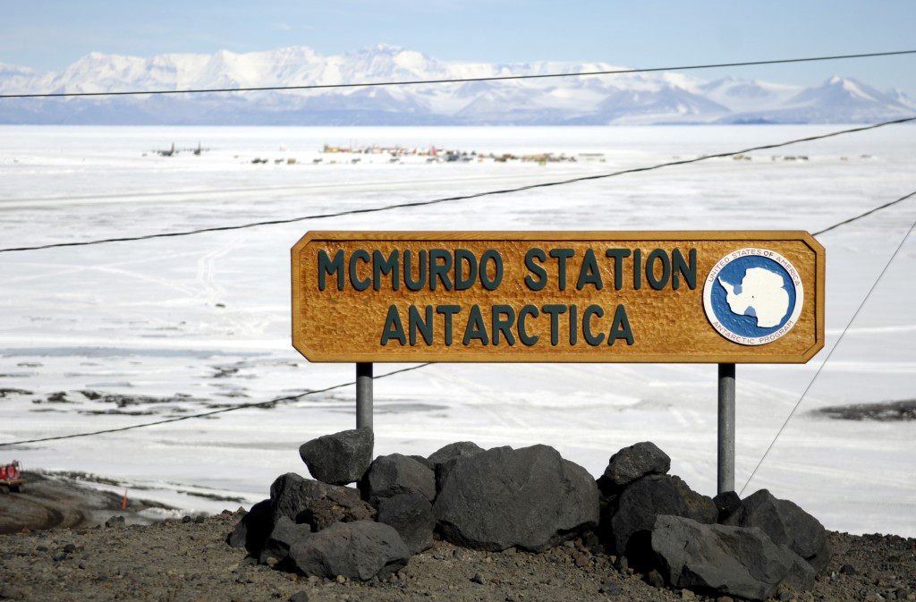 Mc Murdo Station sign with ice on the background