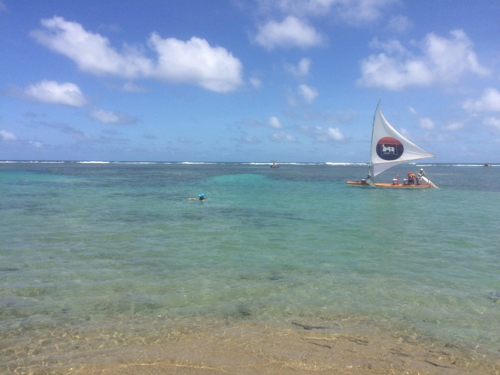 blue sea at Porto de Galinhas with catamaran sailer