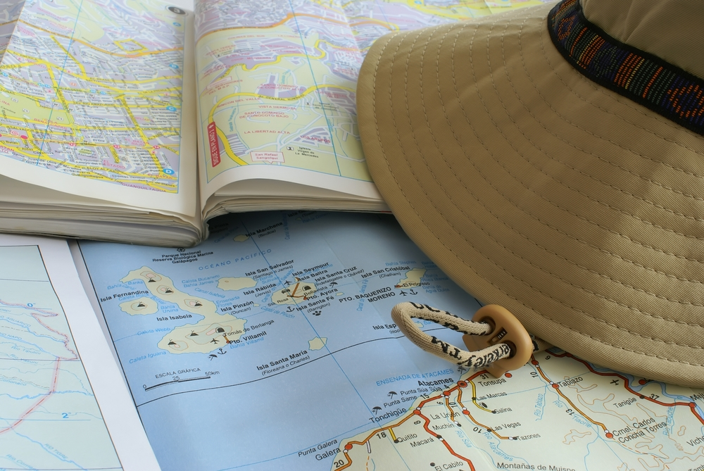 Traveller's hat and maps of Ecuador