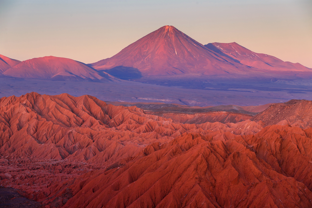 One of the must see destinations in South America: Beautiful red backdrop of the Atacama Desert in Chile
