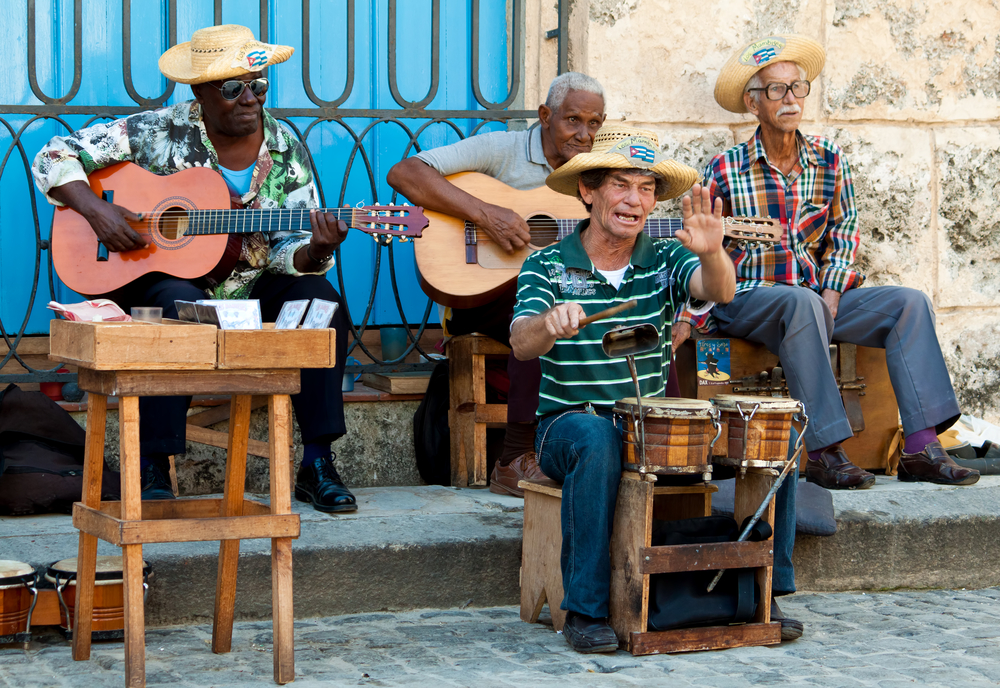Men playing instruments on the street in Havanna Cuba