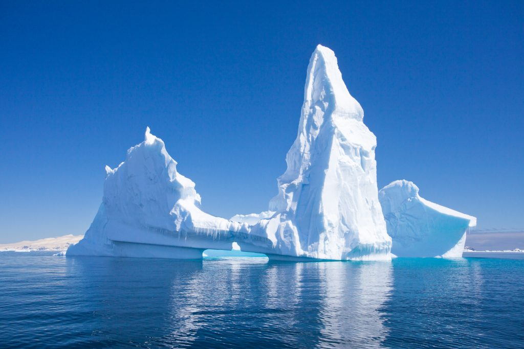 A clear blue sky over an ice formation in Antarctica