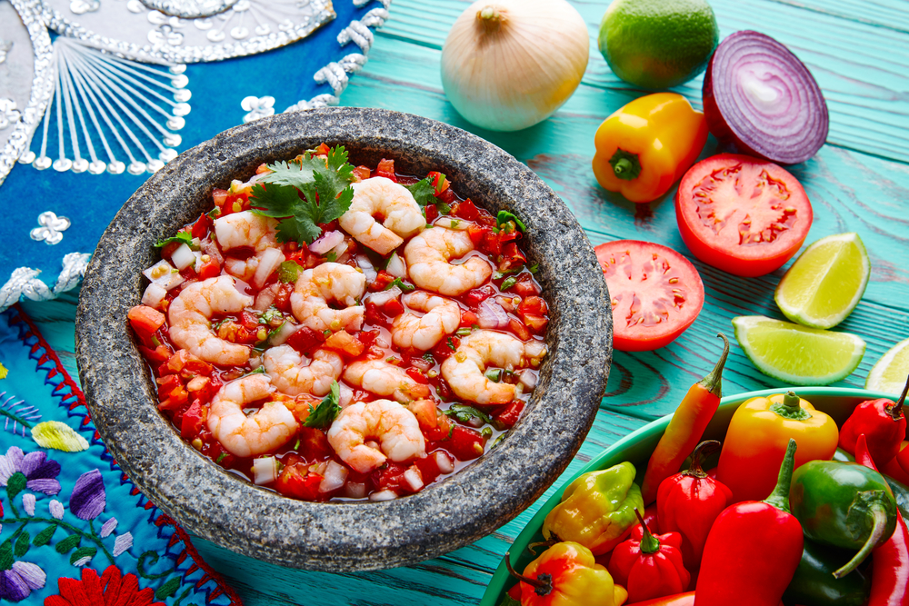 colourful image of food. with prawns, tomatoes and capsicum