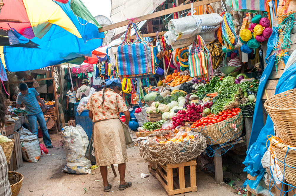 colourful market in narrow street