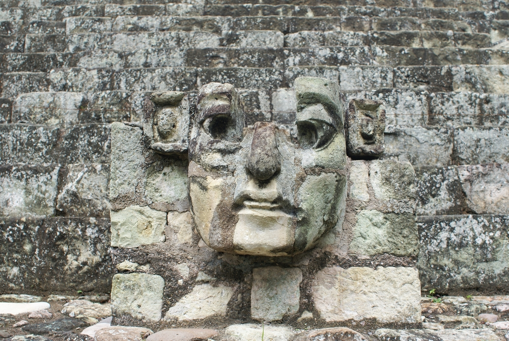 ancient face in wall in Mayan ruin