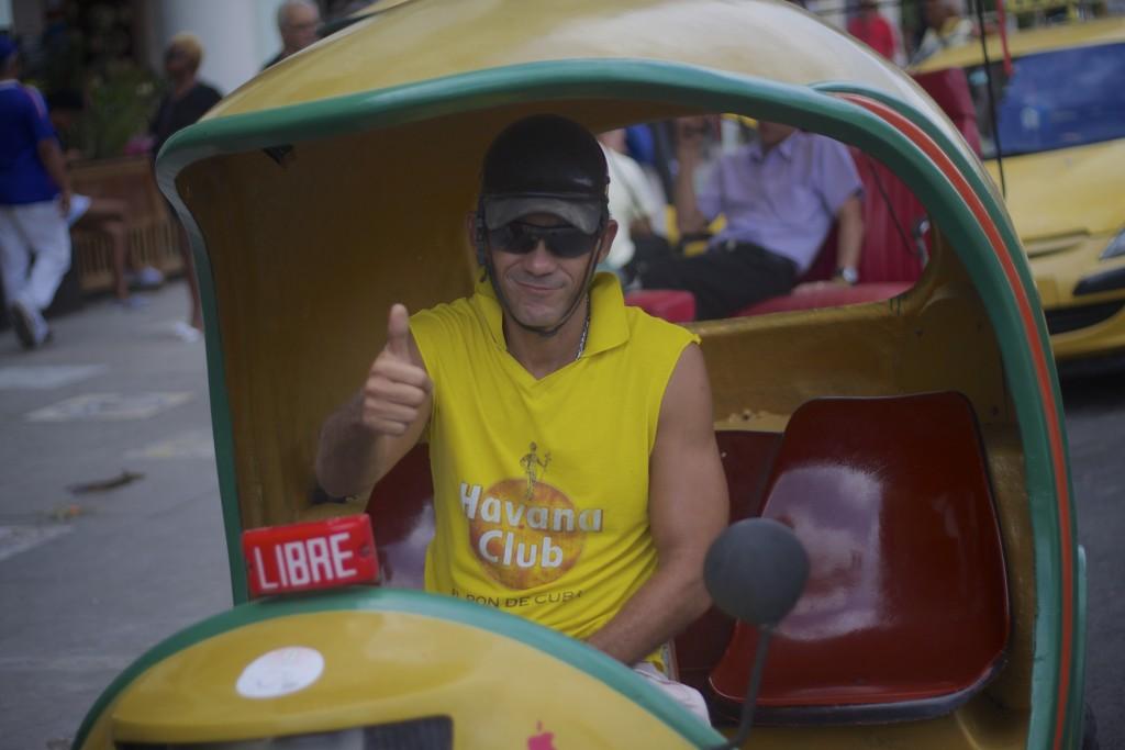 happy men in taxi cuba