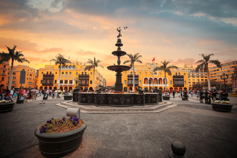 square in lima with big fountain and surrounded by yellow houses