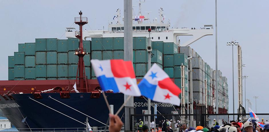 Big cargo ship with flags waving