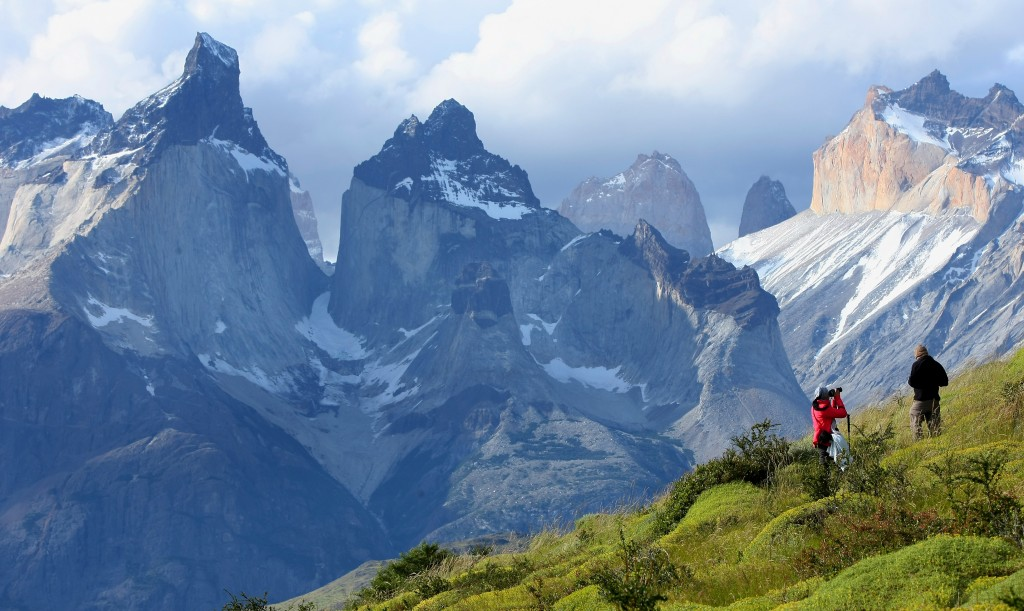 two hikers trekking through high mountains patagonia