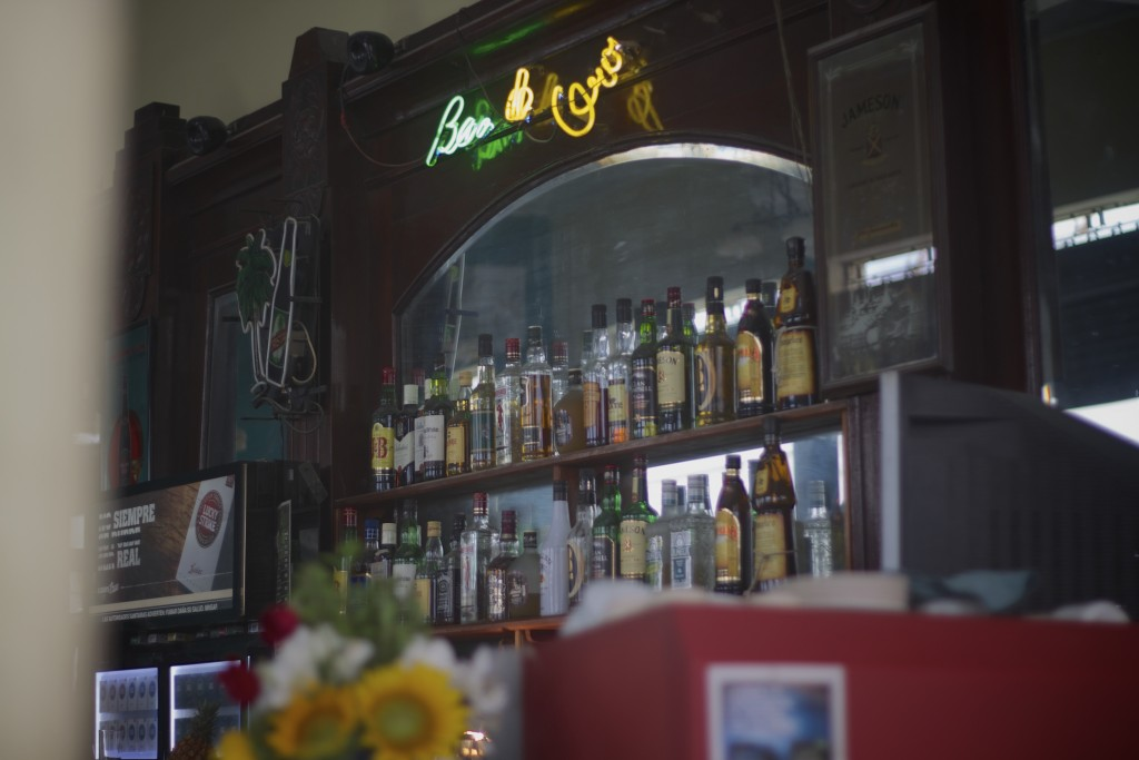 Reasons to visit cuba: bottles of rum behind a bar