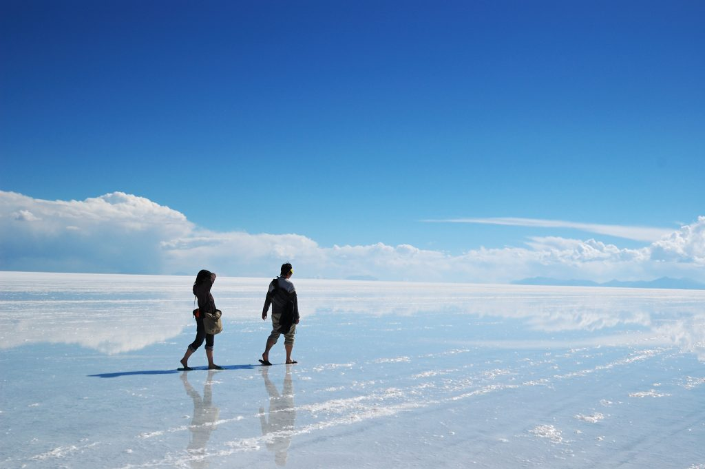 two people walking on the salt flats in Bolivia