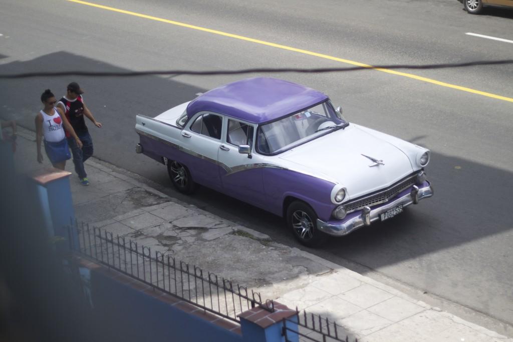 purple vintage car in cuba