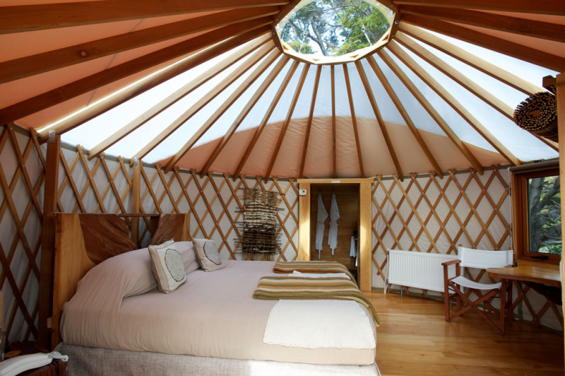 Interior of a yurt with wood and double bed in patagonia