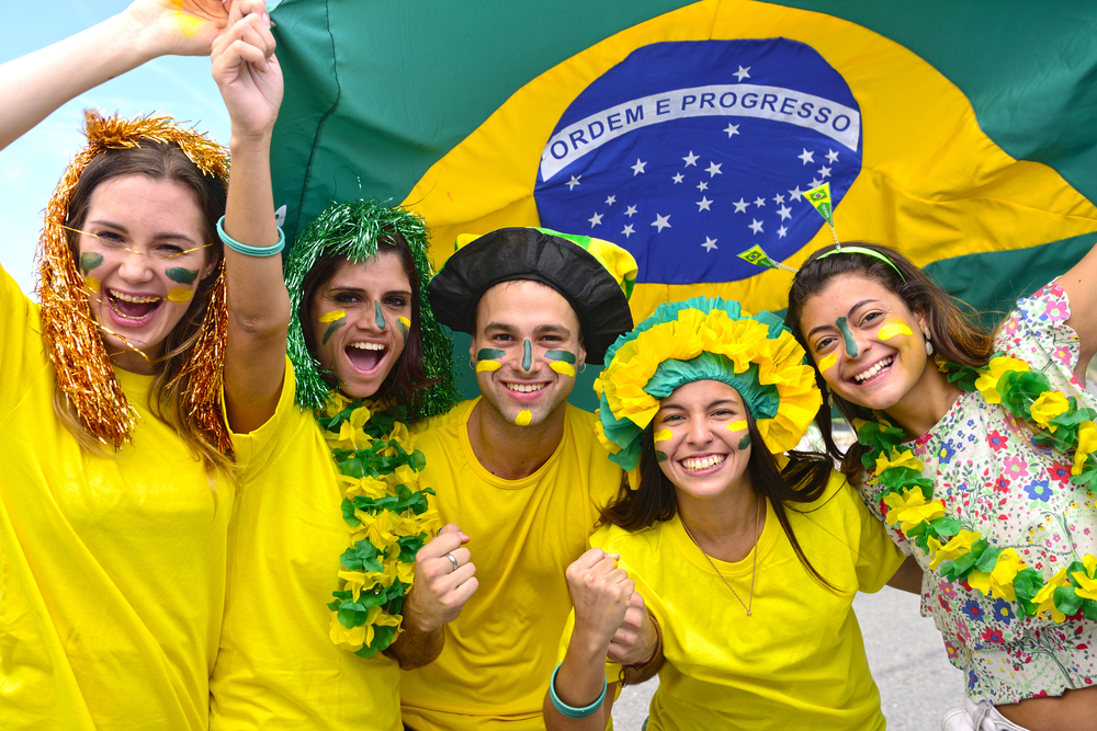 happy brazilian football supporters with flag