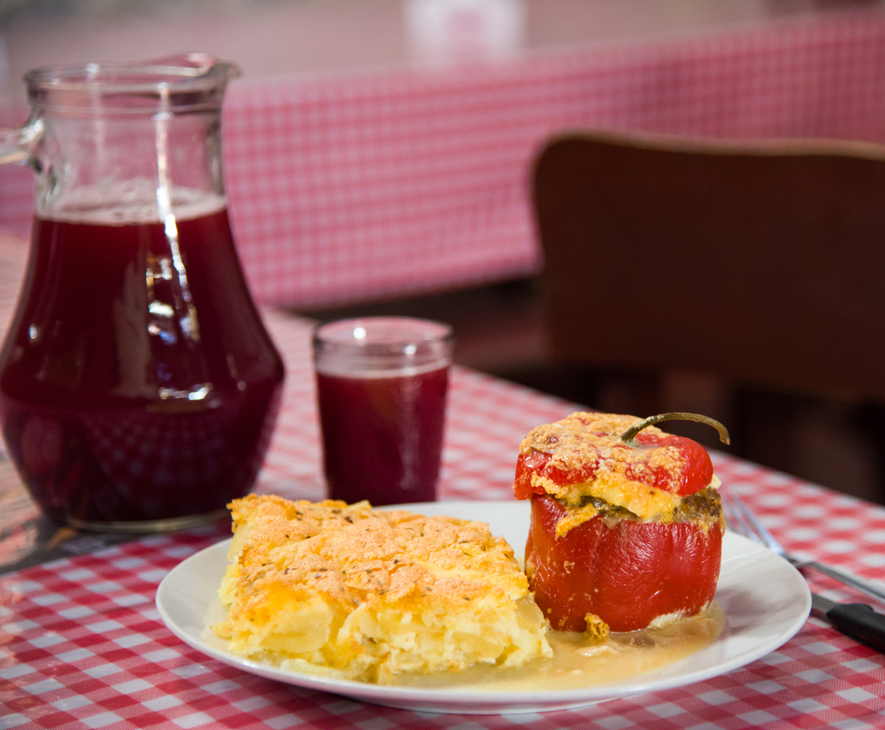 peruvian dishes: stuffed pepper with wine in the background