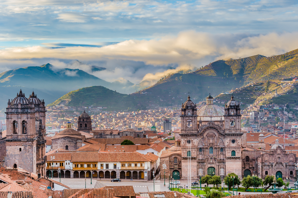 The City Of Cusco In Peru With Mountains Background