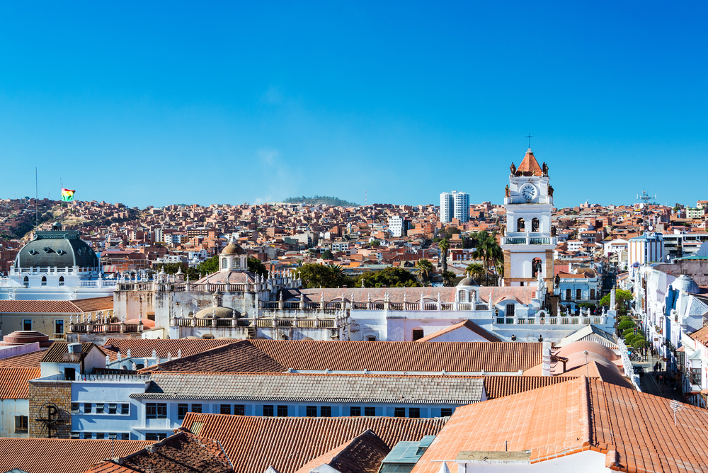 white houses with red roofs and blue sky in bolivia