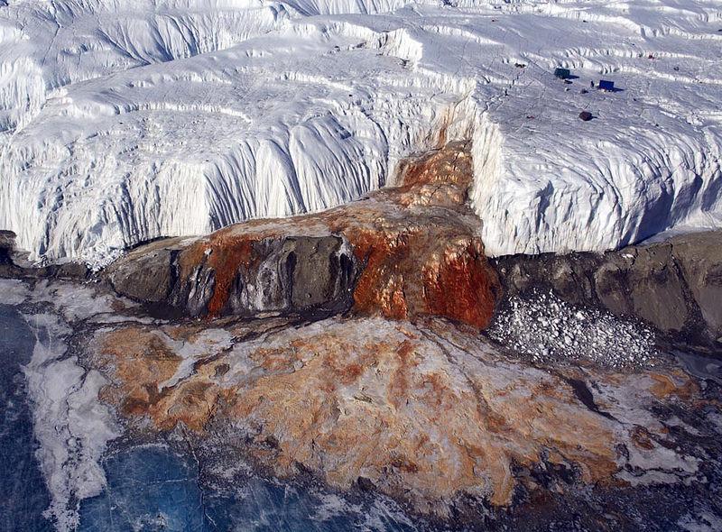A rust coloured glacier in Antarctica.