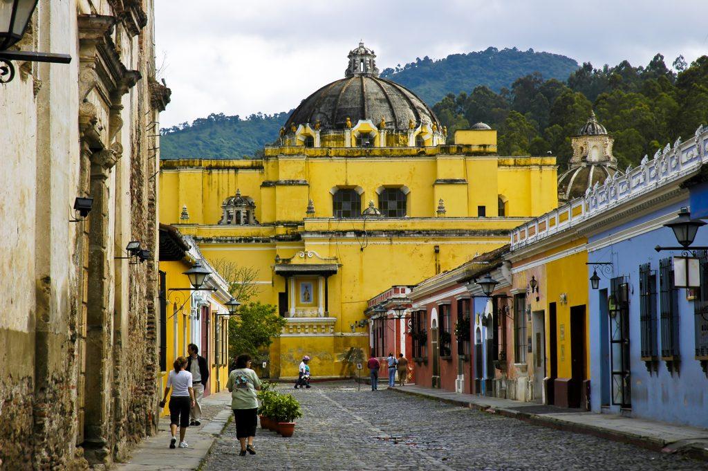 yellow coloured building in narrow street in antigua guatemala