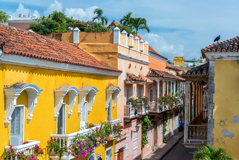 colourful houses with flowers on the balconies in colombia
