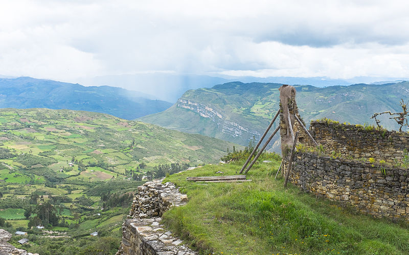 view from the kualap fortress in peru over mountains and green fields