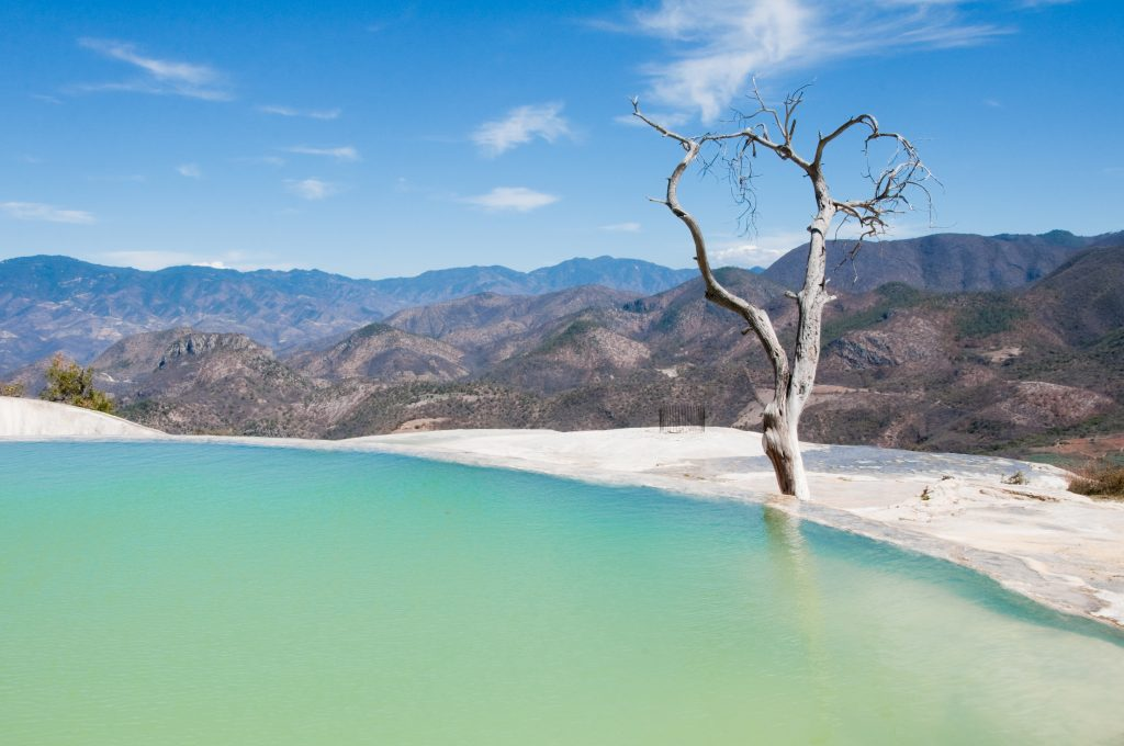 light blue lake with view over mountains and blue sky mexico