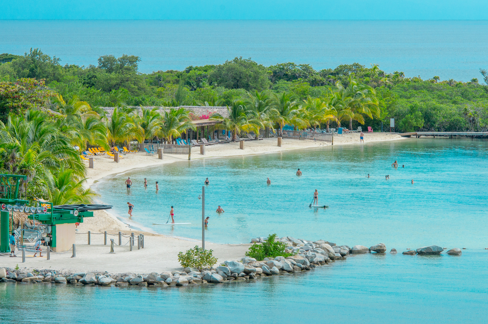 blue waters and white sand beaches with green trees, a highlight in Central America