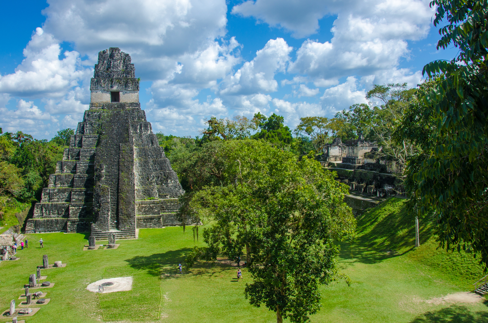 ancient mayan ruin in guatemala with trees