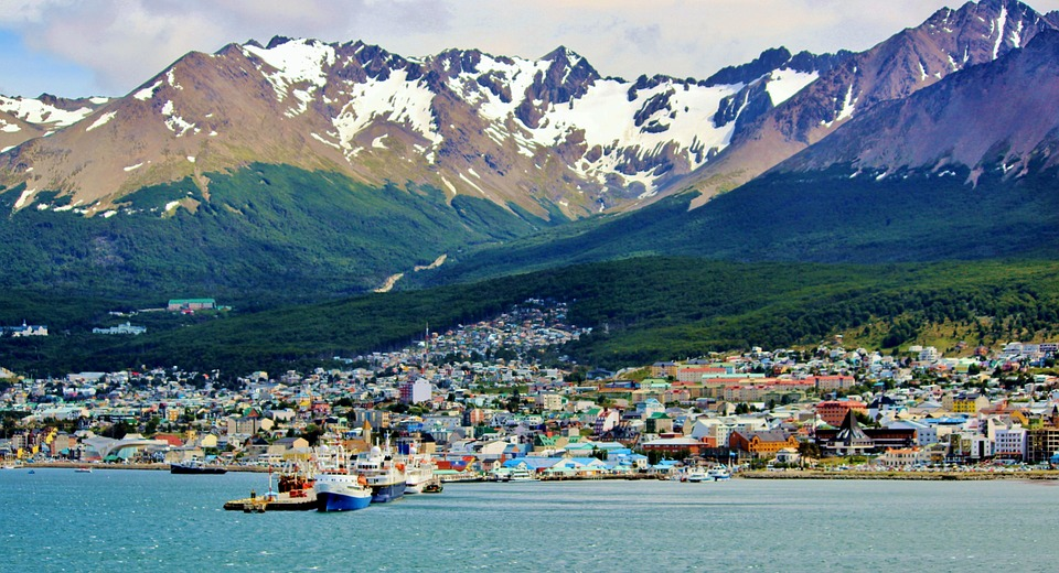 habour city ushuaia with snowy mountains in the background