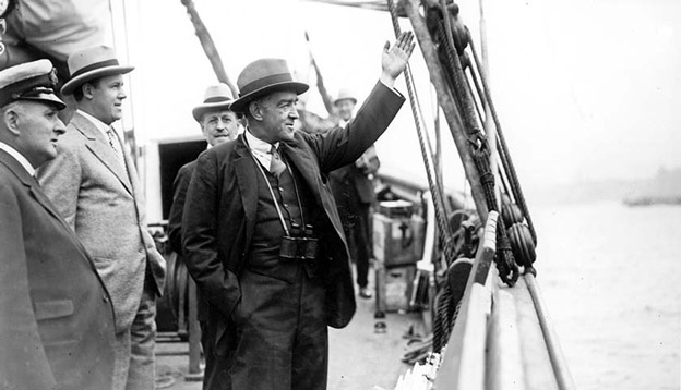 Sir Ernest Shackleton waving goodbye as he departs for his final mission. Photo Credit: Getty Images