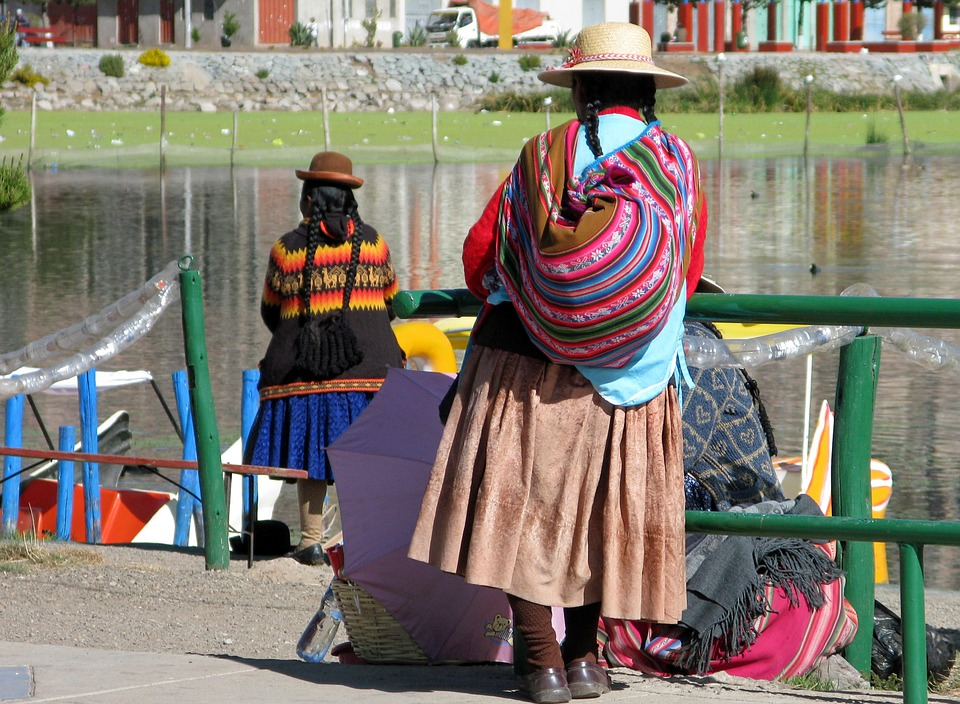 local peruvian woman waiting next to river
