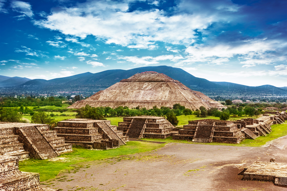 The Teotihuacan Pyramids; ancient pyramids with mountains in background