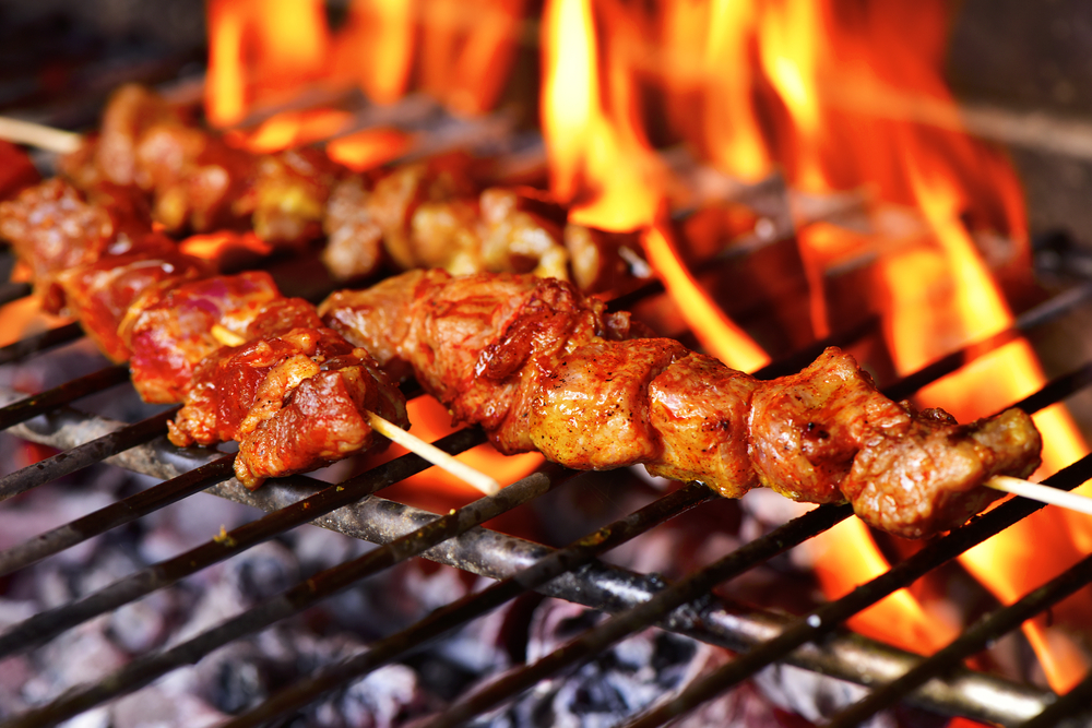 meat skewers on a barbeque