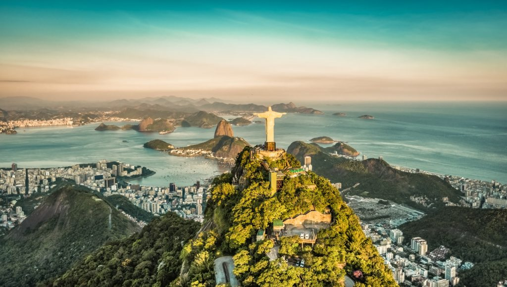 statue of rio and aerial view over the city of rio with the sea in the background