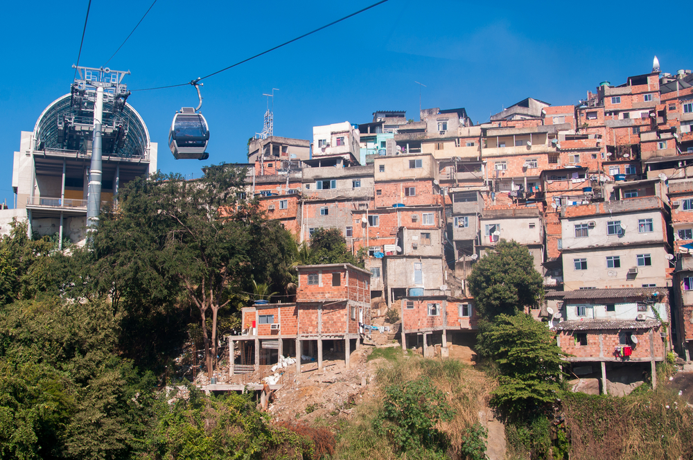 houses build against a mountain hill with cable car
