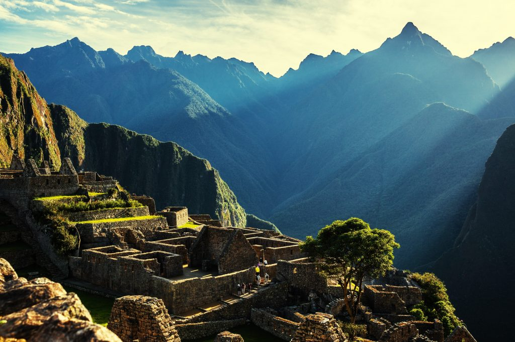 ancient ruins. macchu pichu in Peru, on mountain top with sunlight and mountains in the background