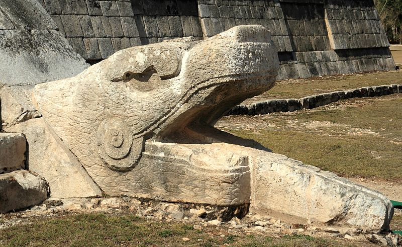 serpent head on ancient mayan ruin in mexico