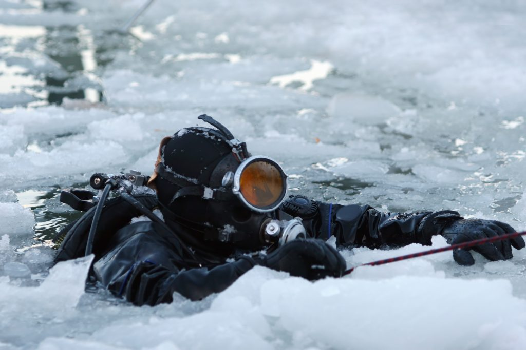 diver in water with ice